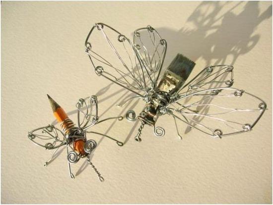 Две бабочки из скрепок и канцелярских принадлежностей