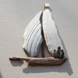 Поделки из речной гальки: минималистичные картинки для украшения стен